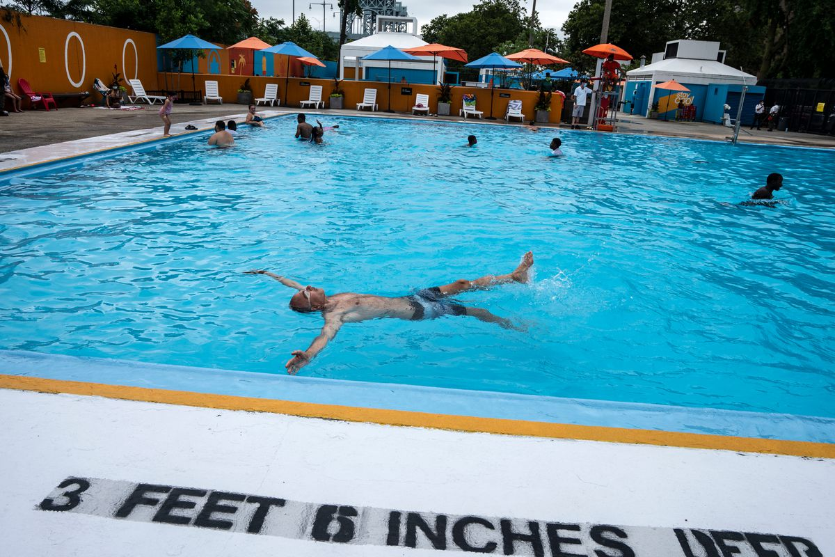 A man practices floating in the shallow end of Harlem's Wagner Pool, July 24, 2020.