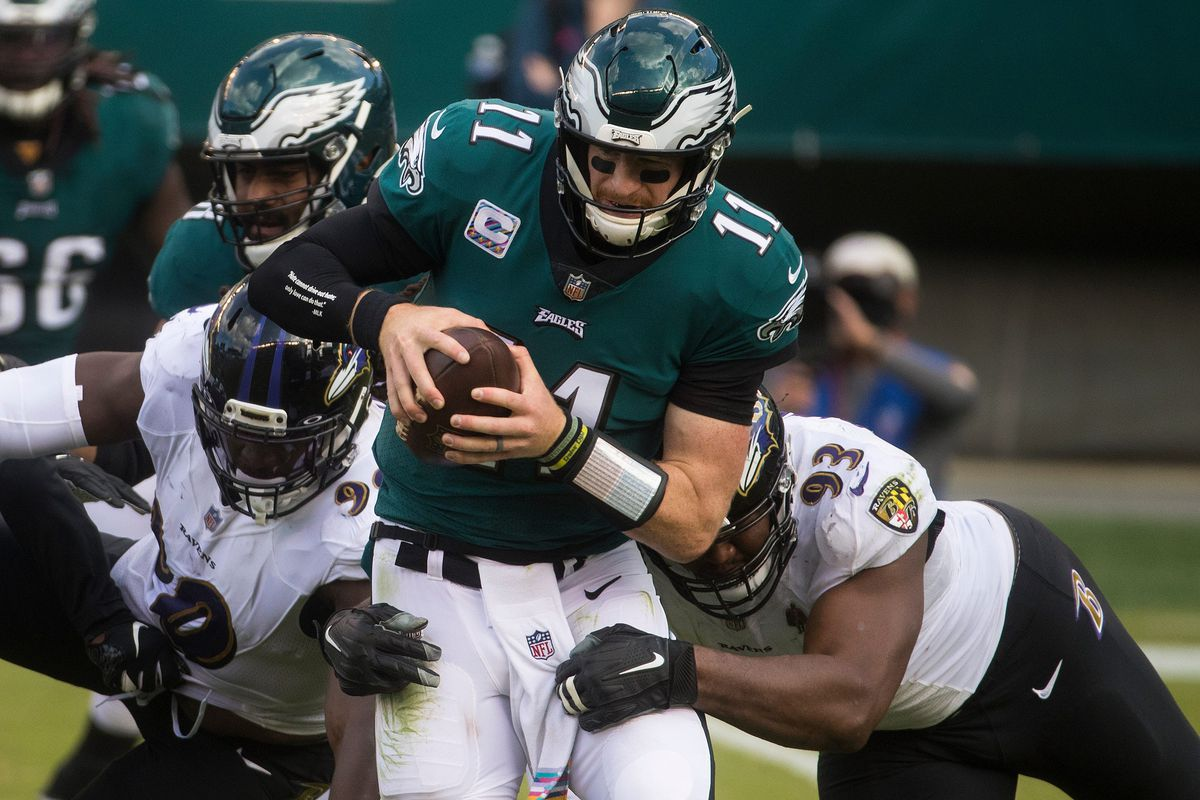 Eagles' Carson Wentz (11) is sacked by the Ravens' Calais Campbell (93) during the third quarter Sunday, Oct. 18, 2020, at Lincoln Financial Field.