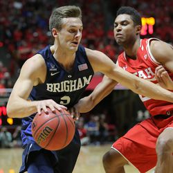 Brigham Young Cougars guard Kyle Collinsworth (5) tries to get past Utah Utes guard Kenneth Ogbe (25) as Utah and BYU play in the Huntsman Center in Salt Lake City Wednesday, Dec. 2, 2015.