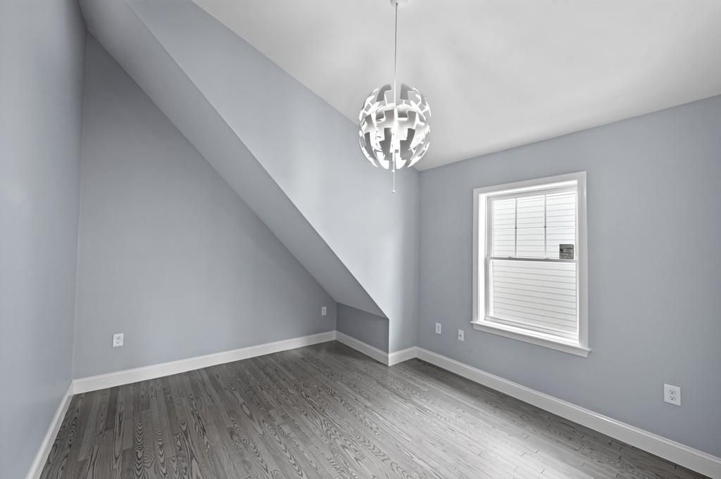 An empty bedroom with a wall indention.
