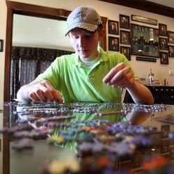 Steve Simmons works on a puzzle with his siblings at home in Kamas on Saturday, Aug. 24, 2013.