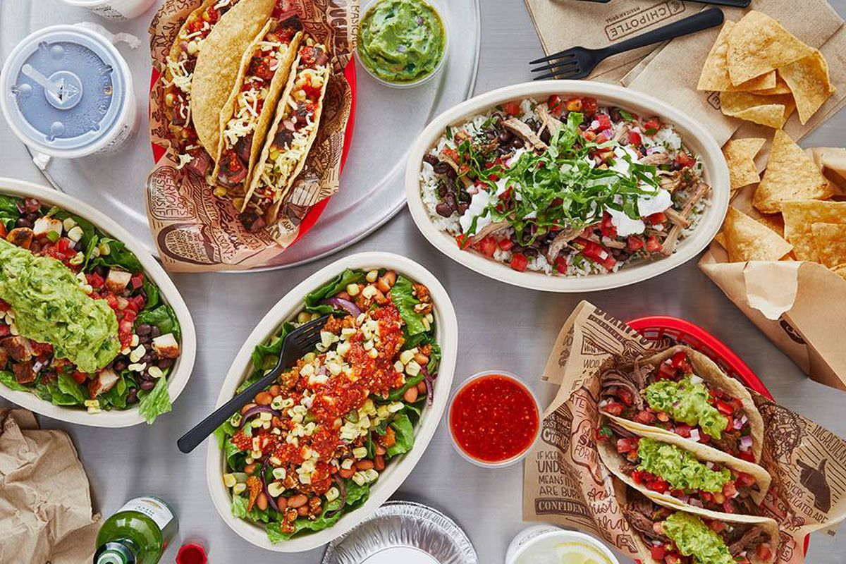 Spread of Chipotle food offerings on a table