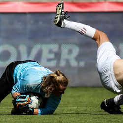 Morgan goalkeeper Tanner Stanley snags the ball as Judge Memorial's Evan Nelson goes flying in the 3A boys soccer championship at Rio Tinto Stadium in Sandy on Tuesday, May 18, 2021.