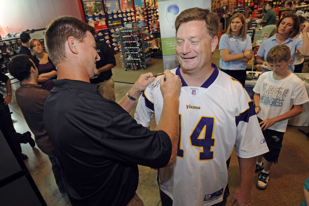 Brad Johnson signing autographs at an event in August 2011.