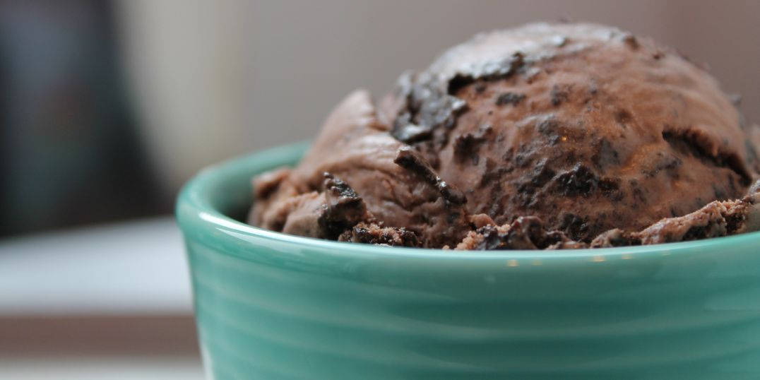 A cup of chocolate chocolate-chip ice cream in a bowl