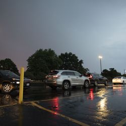 Cars file out of the parking lot after the vigil.   Colin Boyle/Sun-Times