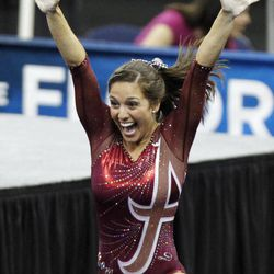 Alabama's Marissa Gutierrez reacts after vaulting during the semifinals of the NCAA college women's gymnastics championships, Friday, April 20, 2012, in Duluth, Ga.