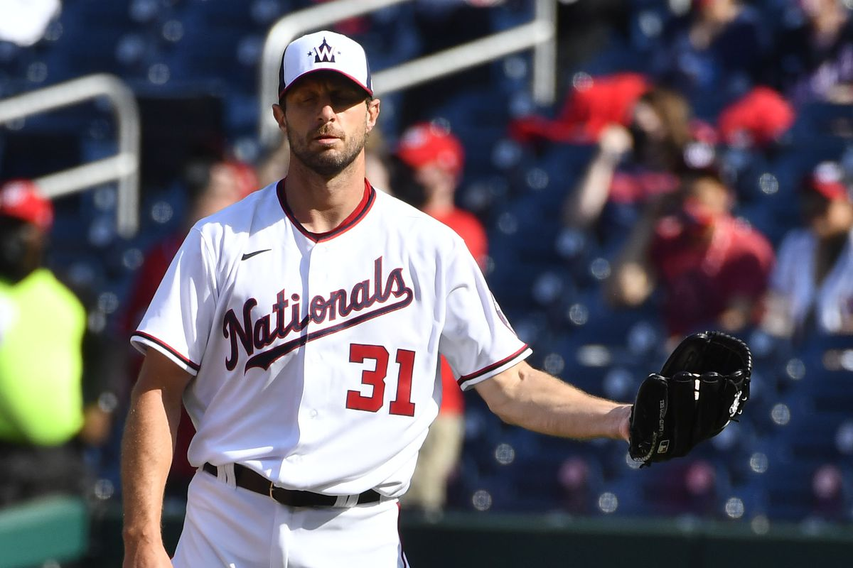 Washington Nationals starting pitcher Max Scherzer reacts after giving up a solo home run to Atlanta Braves right fielder Ronald Acuna Jr. during the first inning at Nationals Park.