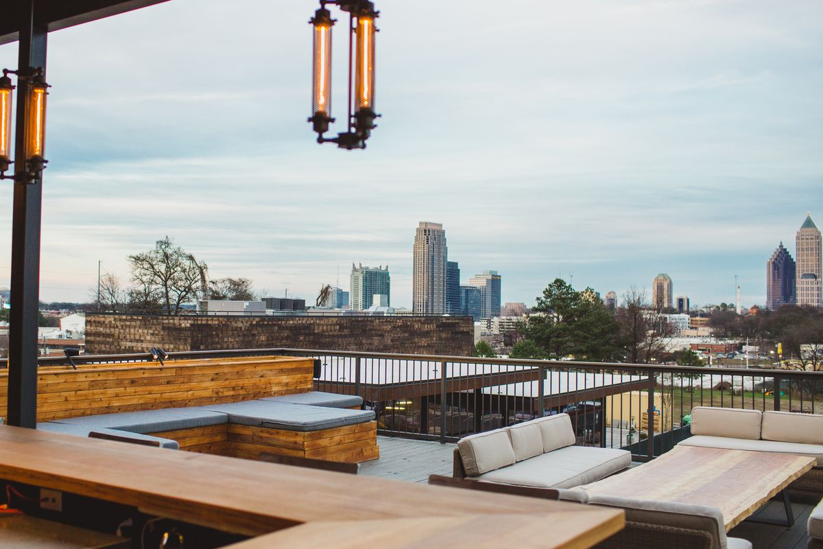 the rooftop patio at o ku sushi complete with a view of midtown phase3 - Rooftop Patio