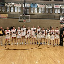 The 3A All-Stars pose with their plaques after Friday's coaches association all-star games at Olympus High School.