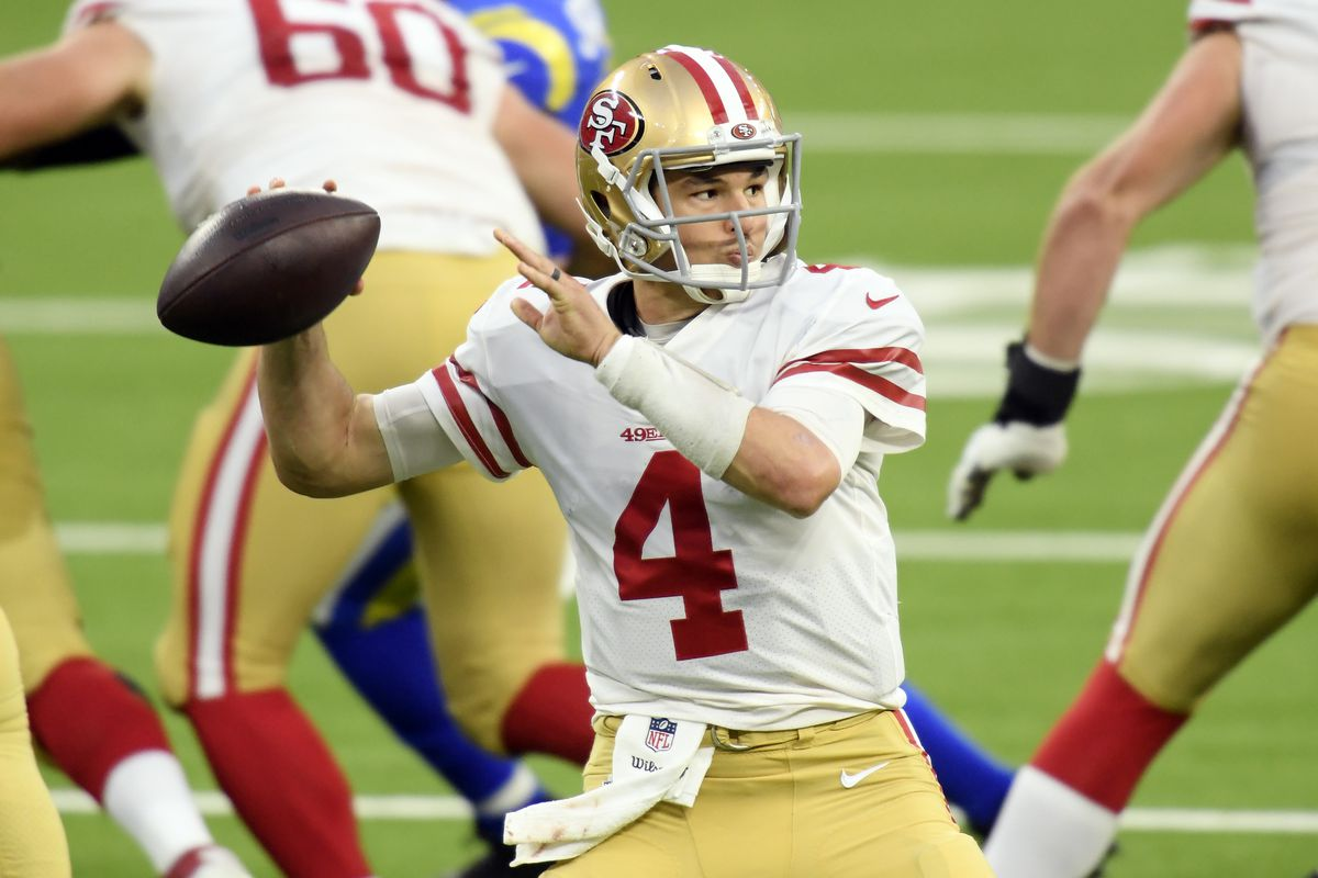Nick Mullens #4 of the San Francisco 49ers throws a pass during the second half against the Los Angeles Rams at SoFi Stadium on November 29, 2020 in Inglewood, California.