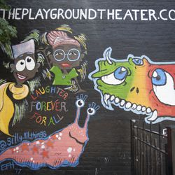 A mural for The Playground Theater on Halsted Avenue in the Boystown.    Colin Boyle/Sun-Times