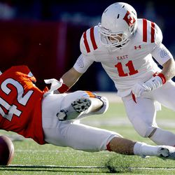 Timpview's #42 Tyler Solorzano dives for and comes up with the ball on a fumble by East's #11 Mickey Taylor as East and Timpview play Thursday, Nov. 10, 2011 in a 4A semifinal game at Rice Eccles stadium in Salt Lake City.