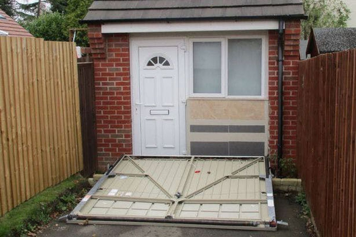 U K Couple Used A Fake Garage Door To Hide Illegal Tiny
