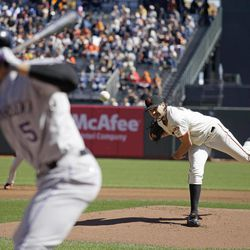 San Francisco Giants starting pitcher Barry Zito, right, throws against Colorado Rockies' Carlos Gonzalez, left, during the first inning of a baseball game in San Francisco, Thursday, Sept. 20, 2012.