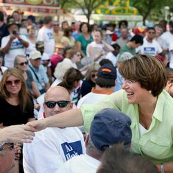 Sen. Amy Klobuchar (DFL) greets supporters before a debate at the MPR News booth at the Minnesota State Fair in Falcon Heights, Minn. Thursday, Aug. 30, 2012.