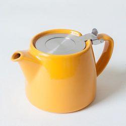 "Ceramic <a href=""http://omoionline.com/stump-teapot-with-sls-lid-infuser-18-oz-mandarin.html#.UzF9ufldX08"">Stump Teapot</a> in Mandarin, $28 at Omoi"