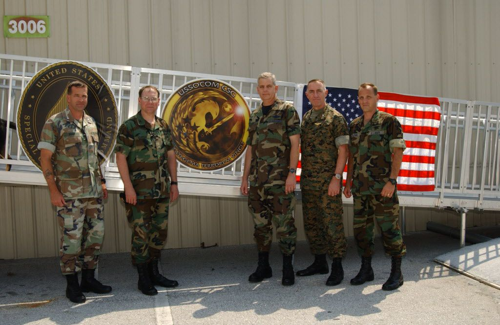 US Special Operations Command (USSOCOM) Headquarters, MacDill AFB FL, in July 2003. Left to right, Marine Colonel Jeff Brady, Dave Schroer, Air Force Colonel Cliff Bray, Marine Colonel Hank Foshee, and Navy SEAL Capt. Jim Coleman.<br>Photo by Chai Gallahu