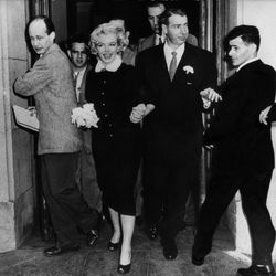 For her San Francisco elopement with Joe Dimaggio on January 14th, 1954 — the actress's second of three marriages — Marilyn Monroe wore a brown broadcloth sheath and matching ermine collar jacket with rhinestone buttons.