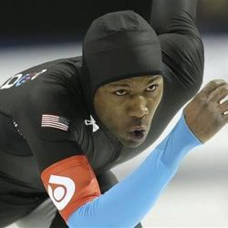 Shani Davis, of the United States, competes in the men's 500-meter race at the U.S. Olympic speedskating trials Saturday, Dec. 28, 2013, in Kearns, Utah.  Davis finished fourth. (AP Photo/Rick Bowmer)