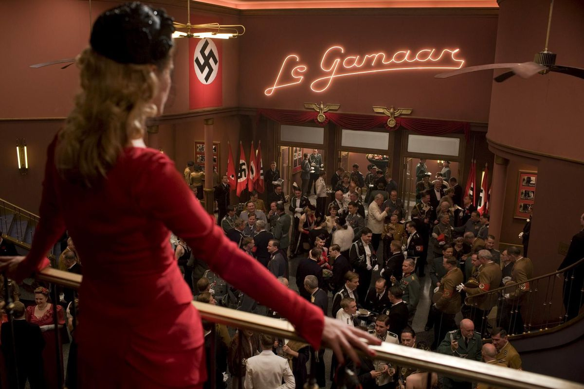 Shoshanna (Laurent) surveys an assembly of Nazis in her movie theater.