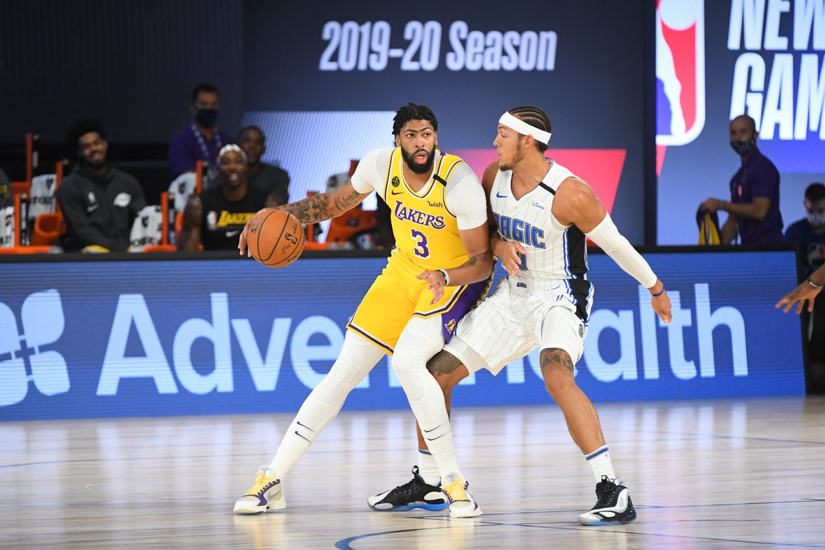 Anthony Davis of the Los Angeles Lakers handles the ball against the Orlando Magic during a scrimmage on July 25, 2020 at HP Field House at ESPN Wide World of Sports in Orlando, Florida.
