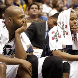 Jazz guards Jamaal Tinsley, left, and Randy Foye look on from the sideline during the second half of the NBA basketball game between the Utah Jazz and the Golden State Warriors at Energy Solutions Arena, Wednesday, Dec. 26, 2012.