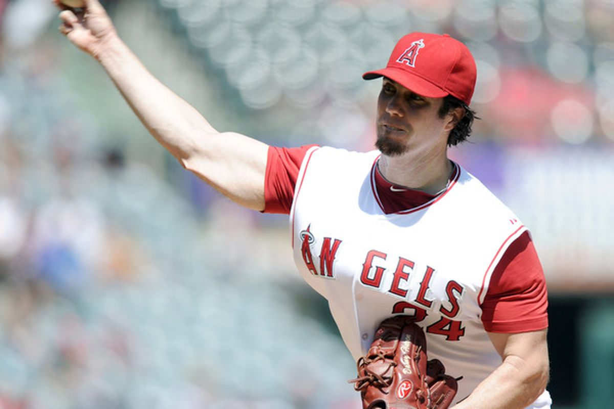 ANAHEIM CA - SEPTEMBER 12:  Dan Haren #24 of the Los Angeles Angels of Anaheim pitches against the Seattle Mariners during the second inning at Angel Stadium on September 12 2010 in Anaheim California.  (Photo by Harry How/Getty Images)