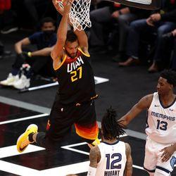 Utah Jazz center Rudy Gobert (27) dunks over Memphis Grizzlies guard Ja Morant (12) and Memphis Grizzlies forward Jaren Jackson Jr. (13) as the Utah Jazz and Memphis Grizzlies play Game 2 of their NBA playoffs first round series at Vivint Arena in Salt Lake City on Wednesday, May 26, 2021. Utah won 141-129.