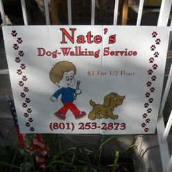 A sign near the front porch at the Christensen home advertises Nate's dogwalking service that he started for a merit badge and used the money from to fund other badges. Nate Christensen completed 132 merit badges in the Boy Scouts of America scouting program. He also happens to be autistic.