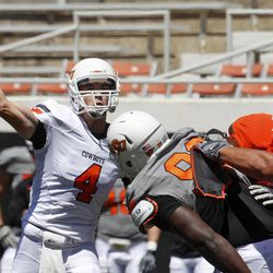 Oklahoma State quarterback J.W. Walsh (4) throws during a spring NCAA college football game in Stillwater, Okla., Saturday, April 21, 2012.