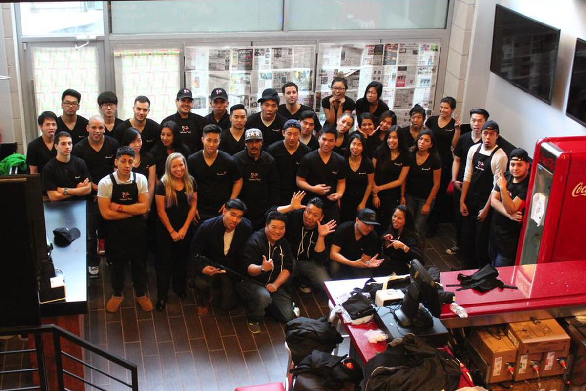 Last month, the staff of the new BonChon store posed for a group shot.