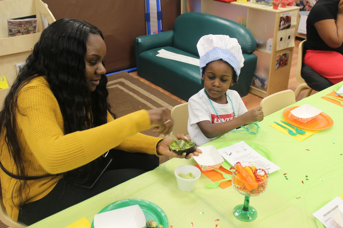 A teacher and student at Little Angels Family Center in Englewood