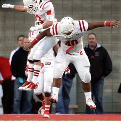 East's Zach Swensen, left, and Patrick Paliau celebrate a defensive pass knock down against Timpview during the 4A football semifinals in Salt Lake City  Thursday, Nov. 10, 2011. East won- 24-10.