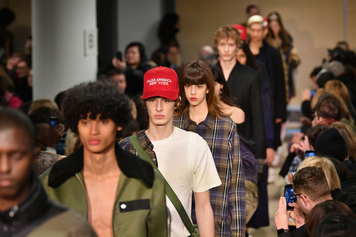 """Models walk down the runway, one of them wearing a """"Make America New York"""" hat."""