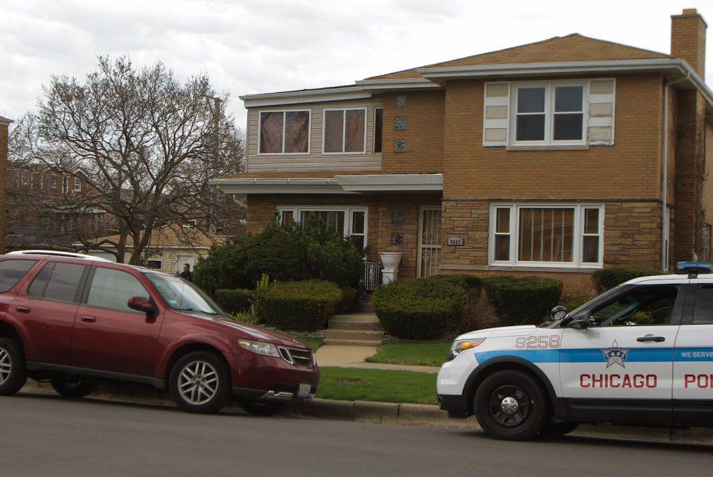 A Chicago Police car in front of the home of Cook County Associate Judge Raymond Myles, 66, in the 9400 block of South Forest. Myles was fatally wounded Monday morning. | Leslie Adkins/For the Sun-Times