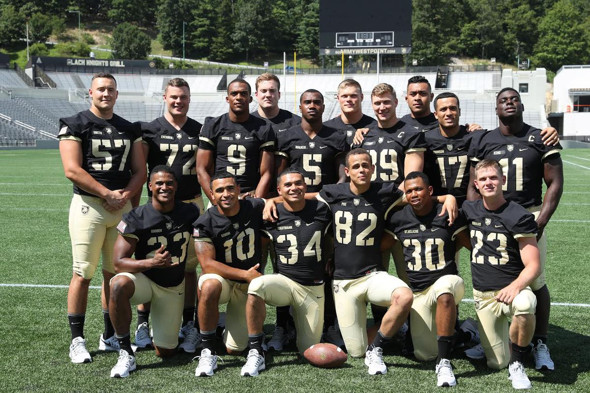 Army seniors participated in media day by taking a group picture on the turf at Michie Stadium.