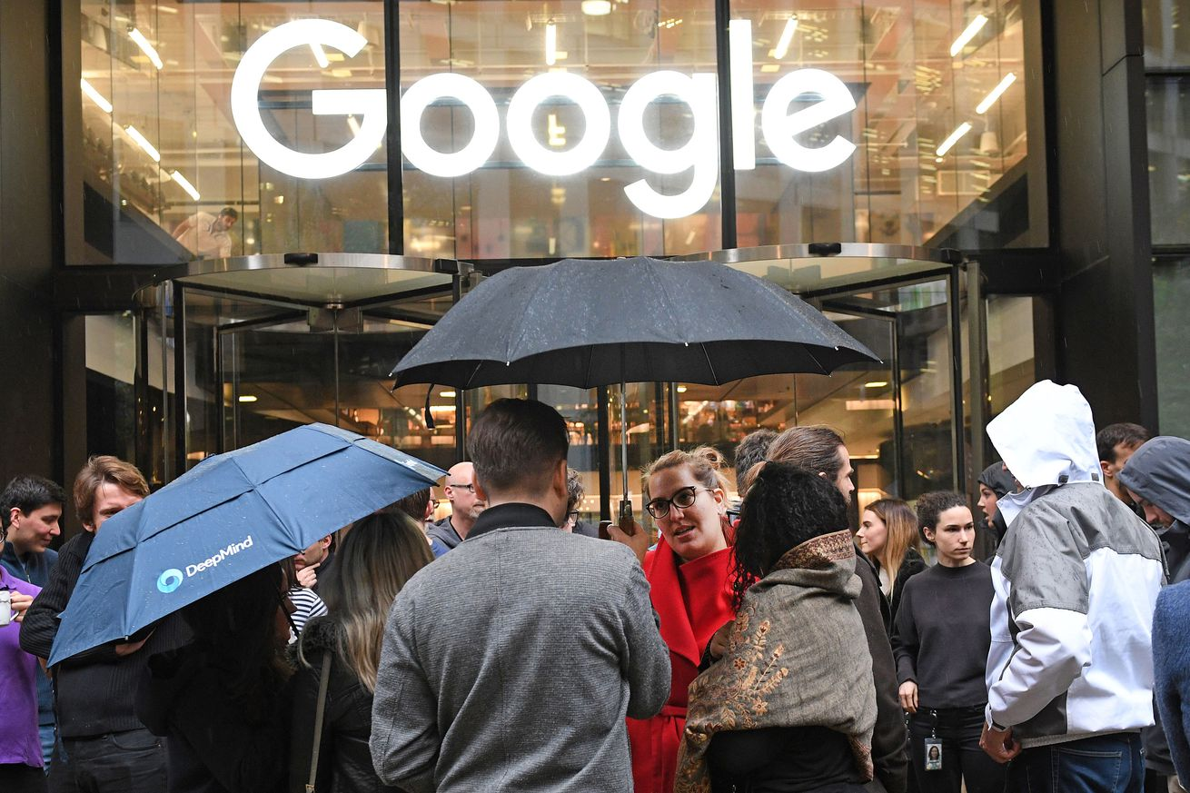 Google employees stand outside the company's London offices during last year's protests.