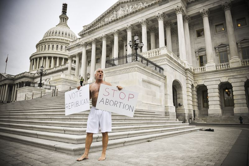 A protester demonstrates for Republicans and against legalized abortion outside the US Capitol on October 5, 2018.
