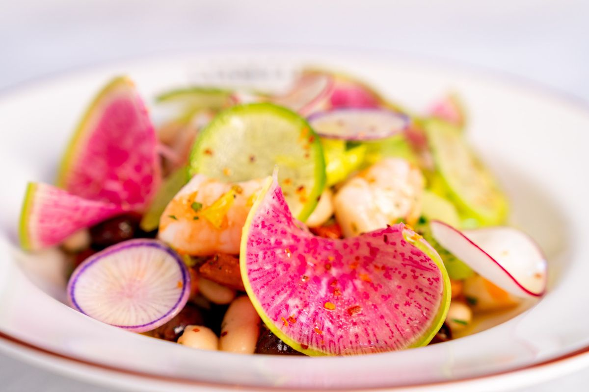 a salad of brightly-colored pickled radishes and shrimp