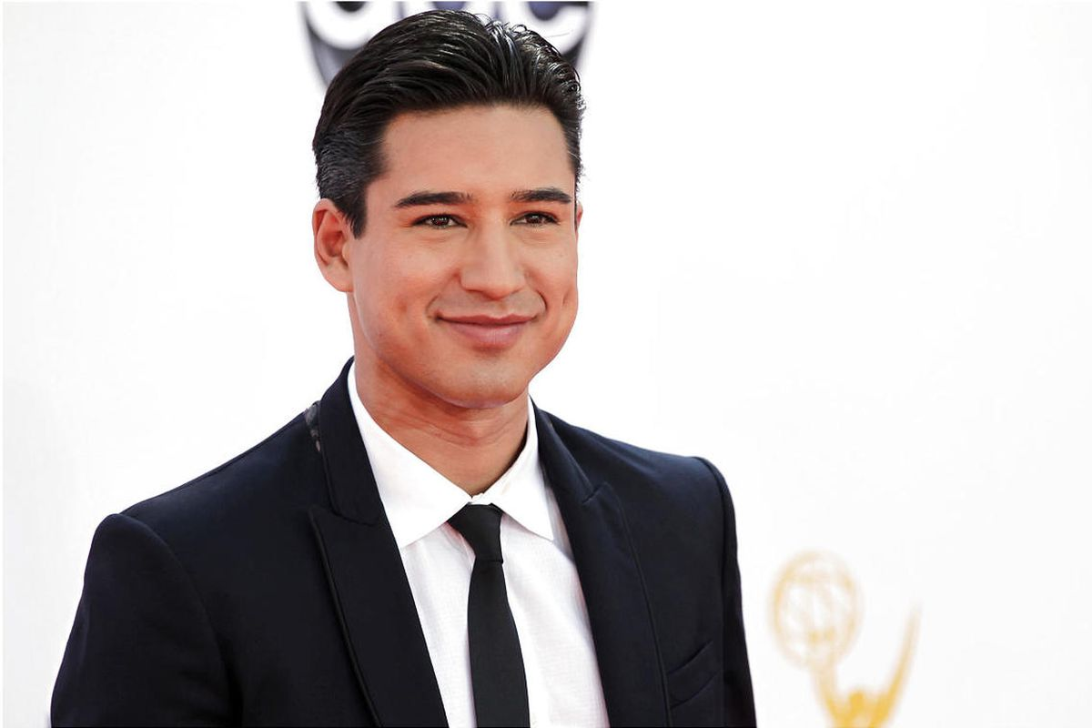 """In this Sept. 23, 2012 file photo, Mario Lopez arrives at the 64th Primetime Emmy Awards at the Nokia Theatre, in Los Angeles. Lopez, along with other """"Saved by the Bell"""" alums will be starring in the reboot of the series on NBC's Peacock."""