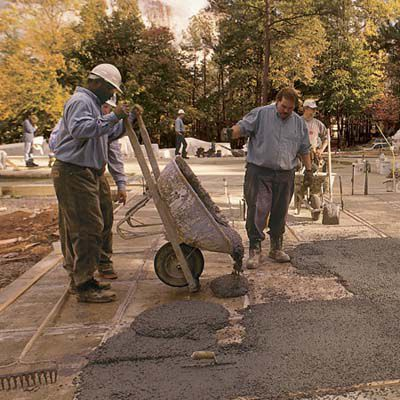 Men Pour Out Mud For Terrazzo Floor