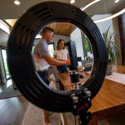 """Mat Shaw and Savanna Shaw prepare to record a cover of the song """"Shallow"""" in their family's home on Thursday, May 14, 2020. The father-daughter duets went viral on YouTube as they shared their passion for music amid the COVID-19 pandemic. """"The one thing more contagious than a virus is hope and so we're just doing our small part in the world to spread some hope,"""" Mat Shaw said."""