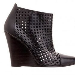 """<strong>Sandro</strong> Audace Perforated Booties, <a href=""""http://us.sandro-paris.com/women-1/shoes/audace.html"""">$565</a>"""
