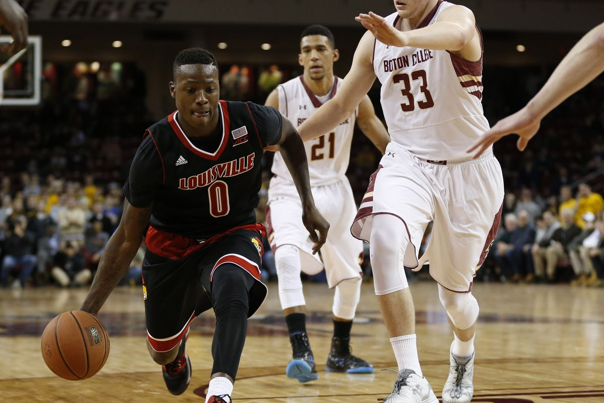 Louisville's Terry Rozier drives to the hoop as Boston College's Olivier Hanlan looks on.