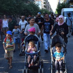 Families of Greek citizens and newly arrived migrants march in a rally for refugee rights in Athens, Greece, in July 2016.