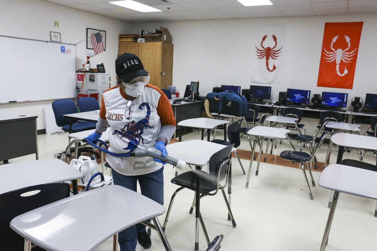In this Wednesday, March 11, 2020, file photo, custodial staffer Hortensia Salinas uses an Electrostatic Clorox Sprayer to spray disinfectant in a classroom at Brownsville Early College High School in Brownsville, Texas. Closing schools to combat the spread of the coronavirus is having a sweeping impact on an annual rite of spring: the standardized tests that are dreaded by millions of students and teachers alike.