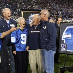 Former BYU player Jim McMahon has his arm around former coach LaVell Edwards as he is honored at Brigham Young University in Provo, Friday, Oct. 3, 2014.