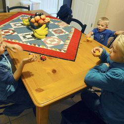 6-year-old Porter Burton, left, along with his sister Mykenzie (8) and brother Logan (3) have a muffin for dessert on Sept. 25.