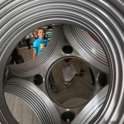Christian Hall looks at an 8-ton, solid stainless steel diamond press in the lobby of the new Tracy Hall Science Center at Weber State University in Ogden on Wednesday, Aug. 24, 2016.